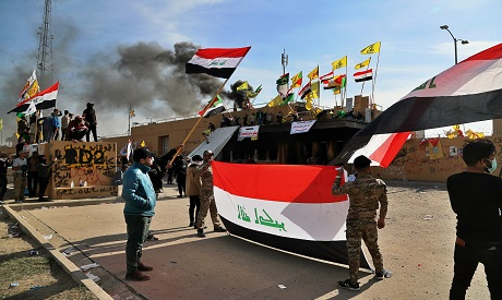 Pro-Iranian militiamen during a sit-in in front of the U.S. embassy in Baghdad