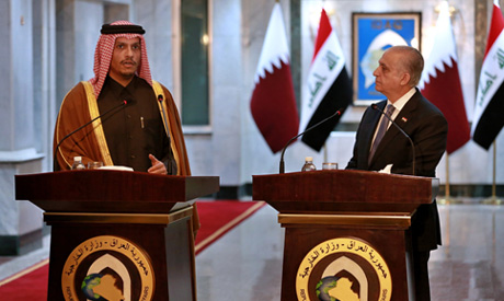 Iraqi Foreign Minister Mohamed Alhahkim, right, holds a press conference with visiting Qatari counte