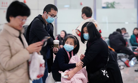 Passengers wearing masks are seen at Hongqiao International Airport in Shanghai, China January 20, 2