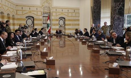 President Michel Aoun, center, speaks with Prime Minister Hassan Diab, center left, during the cabin