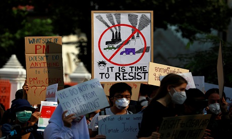 Environmental activists rally to demand rights to clean air, near the Thai Government House in Bangk