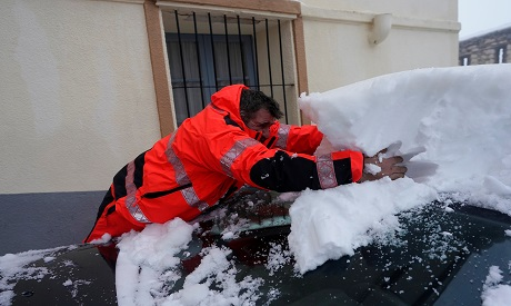 "A man remove snow during the storm ""Gloria"" in Morella"