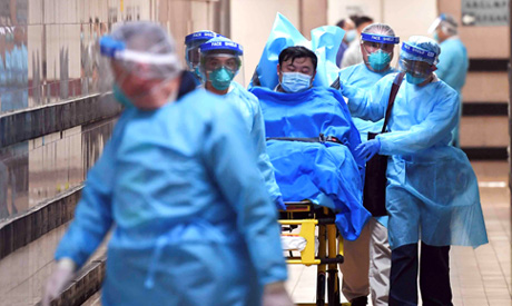 Medical staff transfer a patient of a highly suspected case of a new coronavirus at the Queen Elizab