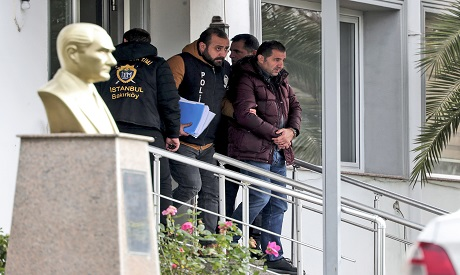 Turkish police officers escort suspects