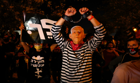 Israeli protester in a protest against the PM