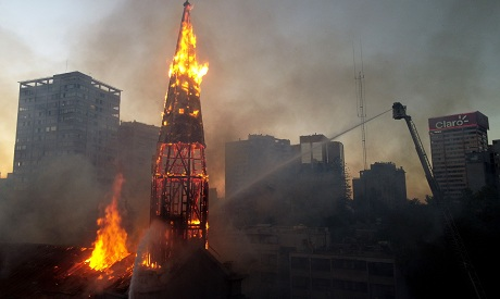 View of the church of Asuncion in flames after being set on fire by demonstrators  AFP