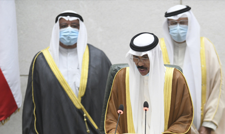 The new Emir of Kuwait Sheikh Nawaf Al Ahmad Al Sabah, middle, recites the constitutional oath at th