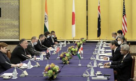 U.S. Secretary of State Mike Pompeo, second left, speaks to Japan Foreign Minister Toshimitsu Motegi