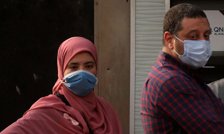 File Photo: People are pictured wearing protective face masks, amid concerns over the coronavirus di