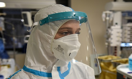 Coronavirus:  medical worker is wearing PPE REUTERS
