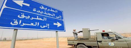 A signpost close to the Arar border crossing between Iraq and Saudi Arabia