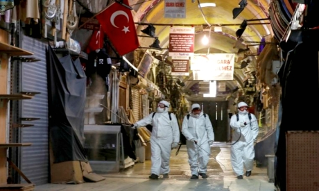 Workers spray disinfectant in Istanbul