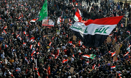 Supporters of Iraqi al-Sadr gather in support of cleric at Tahrir Square in Baghdad REUTERS