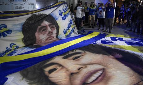 Supporters of Argentine former football star and coach of Gimnasia y Esgrima La Plata Diego Maradona