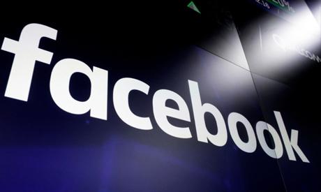File photo: shows the Facebook logo on screens at the Nasdaq MarketSite, in New York