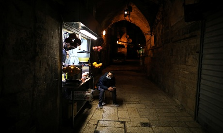 Pandemic brings dark times to Jerusalem