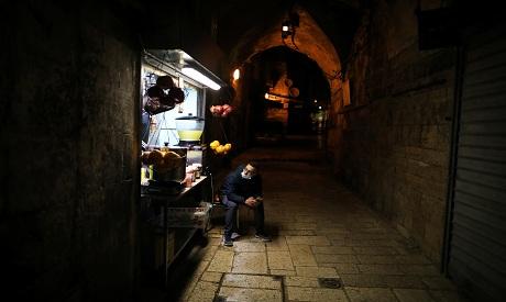 Pandemic brings dark times to Jerusalem