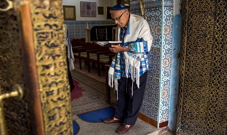 Moroccan Jews and Israeli Jewish tourists participate in a religious ceremony AFP