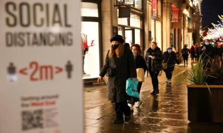 People walk along Regent Street, London