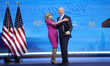 Joe Biden (R) embraces his wife Dr. Jill Biden AFP