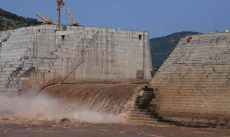 File photo: Water flows through GERD as it undergoes construction works (photo: Reuters)
