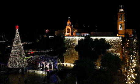 Christmas tree is lit outside the Church of the Nativity in Bethlehem