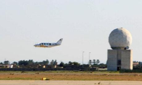 An airplane flies over Tripoli International Airport