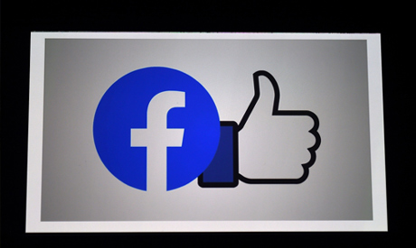 File photo illustration a Facebook App logo is displayed on a smartphone on March 25, 2020 in Arling