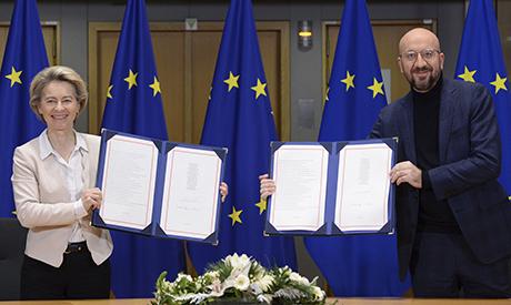 European Commission President Ursula von der Leyen, left, and European Council President Charles Mic