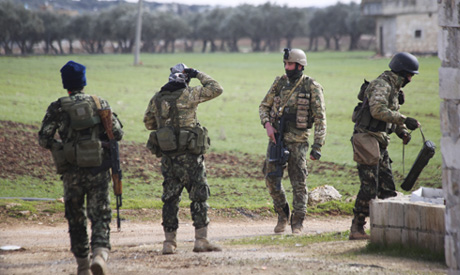 Turkish backed fighter prepare to go to the frontline in the Syrian province of Idlib, Monday, Feb.