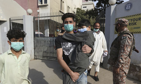 Residents of areas affected by a toxic gas leak, visit a hospital, in Karachi, Pakistan, Tuesday, Fe
