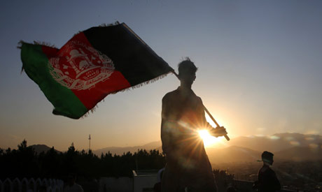 A man waving an Afghan flag during an Independence Day celebration in Kabul in 2019 (AP)