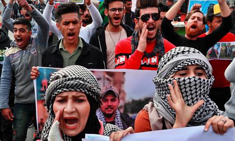 Iraq  in bid  to form  a government,  end turmoil
