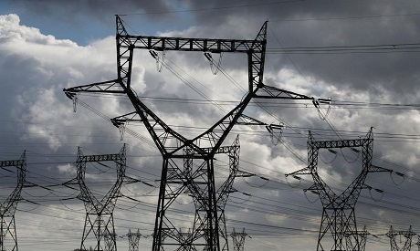 """Pylons carrying high-tension electricity power lines """"Reuters"""""""
