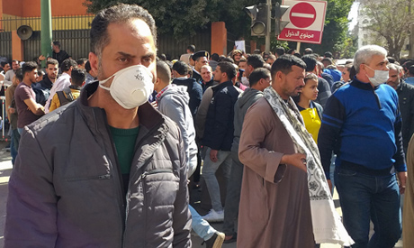 Egyptians bound for GCC countries gather in front of the Central Public Health Laboratories in downt