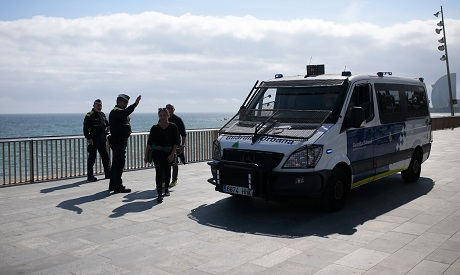 Police officers prevent accessing the beach in Spain