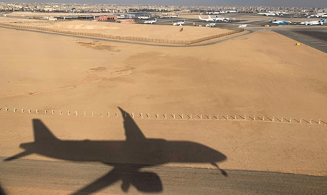 Shadow of an Egyptair airplane landing at Cairo International Airport in Cairo (Reuters)