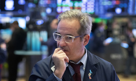A trader works the floor at the New York Stock Exchange, Tuesday, March 17, 2020 in New York. (AP)