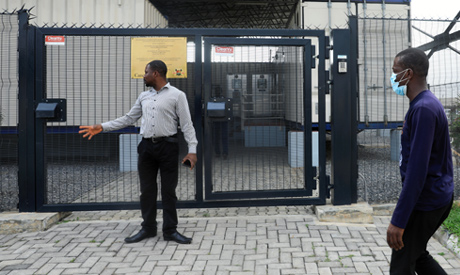 Men stand in front of the Lagos state biosecurity facility at the Mainland hospital in Yaba Lagos, N
