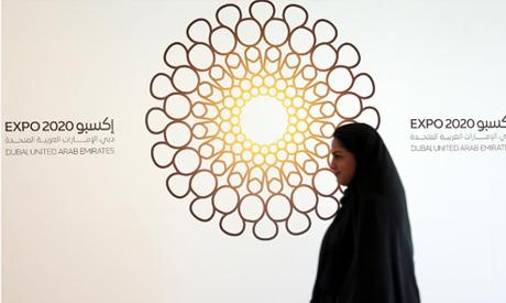 File photo: A woman walks past the logo of the Expo 2020 in Dubai, United Arab Emirates, April 3, 20