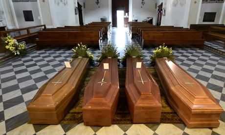 Coffins are seen inside a church in Serina near Bergamo, one of Italy