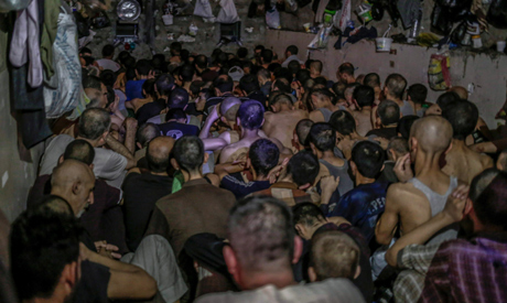 File photo: July 18, 2017 file photo, suspected Islamic State members sit inside a small room in a p