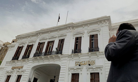 A man uses a mobile phone in front of the Egyptian Ministry of Health following an outbreak of the c