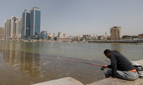 A man fishes along the bank of the Nile River in Cairo, Egypt March 31, 2020. (Reuters)