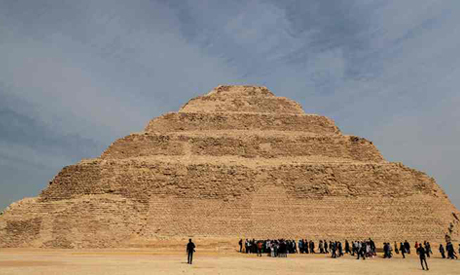 Tourists visist the step pyramid of Djoser in Egypt
