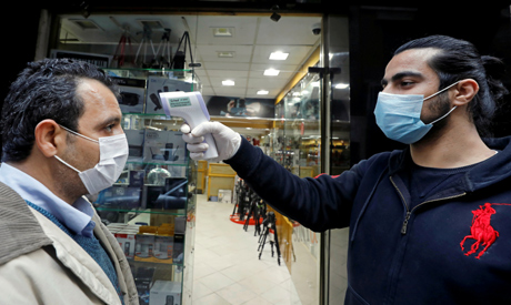 FILE PHOTO: A shop assistant checks customers
