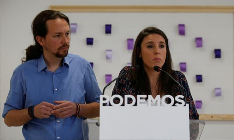 Podemos (We can) party members Pablo Iglesias and Irene Montero attend a press conference regarding