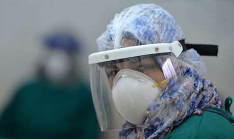 A member of the medical staff at the infectious diseases unit of the Imbaba hospital in the capital