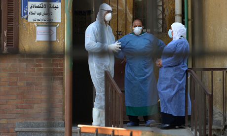 Members of the medical staff at the infectious diseases unit of the Imbaba hospital in the capital C