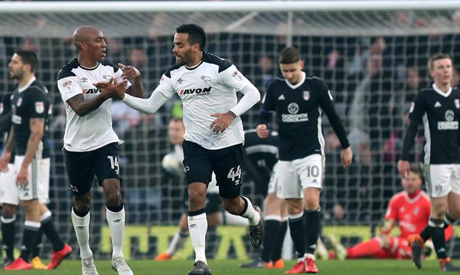 File photo: Derby County's Tom Huddlestone celebrates scoring their first goal with Andre Wisdom (Re